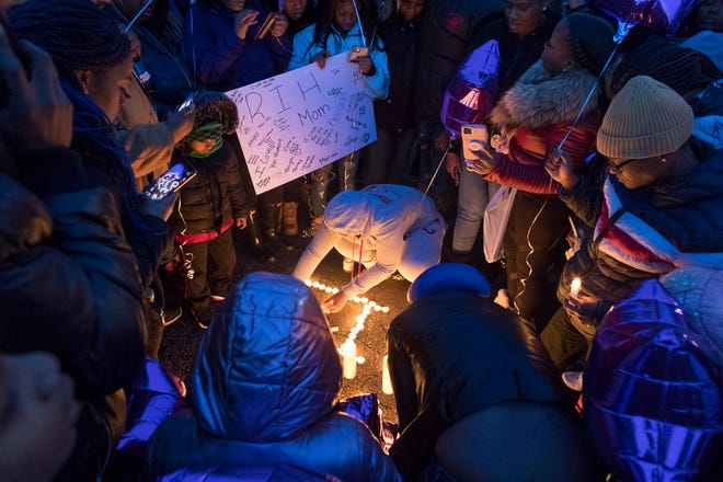 Friends and family of Annie Sandifer hold a vigil Saturday evening for her. Sandifer died following a drive-by shooting in the 4300 block of North 60th Street. Sandifer was pregnant. Her infant child survived the shooting.