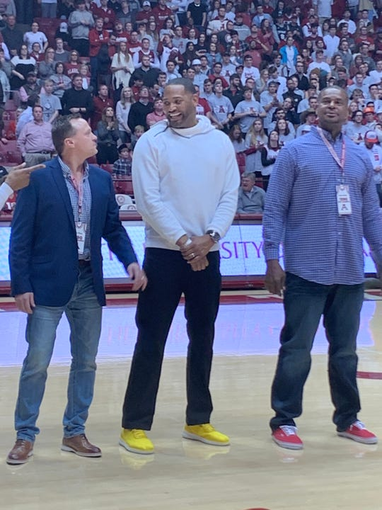 Former NBA player Robert Horry jokes with former Alabama teammates at center court as the Crimson Tide's 1989-90 team is honored during halftime of Saturday's 82-78 loss to Arkansas on Saturday in Coleman Coliseum in Tuscaloosa. The halftime ceremony was part of the 30-year anniversary reunion of the first of Alabama's back-to-back Sweet 16 appearances in 1990. (Photo by Alex Byington/Montgomery Advertiser)