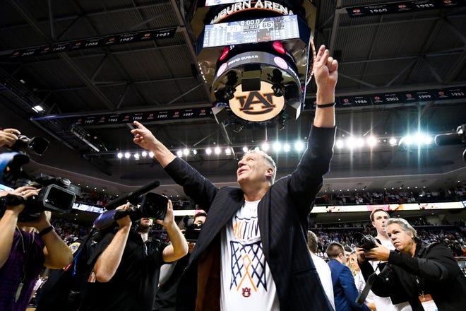 Auburn coach Bruce Pearl celebrates the team's 75-66 win over Kentucky on Saturday, Feb. 1, 2020, in Auburn, Ala.