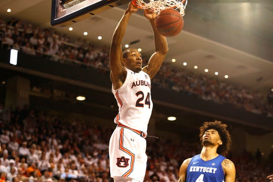 Feb 1, 2020; Auburn, Alabama, USA;  Auburn Tigers forward Anfernee McLemore (24) makes a dunk during the second half against the Kentucky Wildcats at Auburn Arena. Mandatory Credit: John Reed-USA TODAY Sports