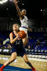 MTSU's Charity Savage (35) goes up to block a shot against UTSA on Saturday.