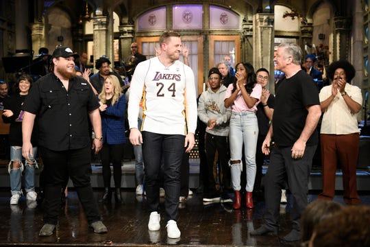 "SATURDAY NIGHT LIVE -- ""JJ Watt"" Episode 1779 -- Pictured: (l-r) Musical guest Luke Combs, host JJ Watt, and Alec Baldwin during Goodnights & Credits on Saturday, February 1, 2020 -- (Photo by: Will Heath/NBC)"