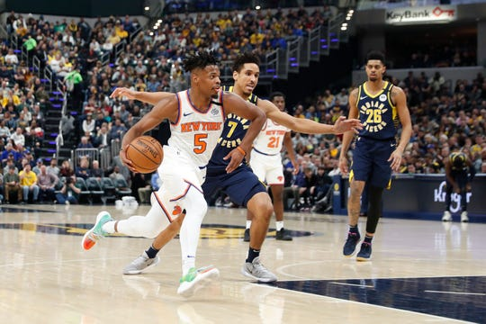Feb 1, 2020; Indianapolis, Indiana, USA; New York Knicks guard Dennis Smith Jr. (5) drives to the basket against Indiana Pacers guard Malcom Brogdon (7) during the first quarter at Bankers Life Fieldhouse. Mandatory Credit: Brian Spurlock-USA TODAY Sports