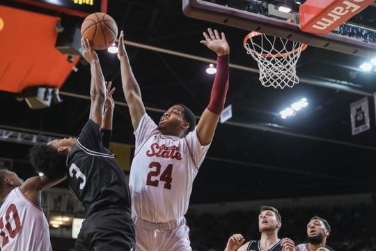 NMSU freshman forward William McNair (24) blocks a shot as the New Mexico State Aggies face off against the Grand Canyon State Lopes at the Pan American Center in Las Cruces on Saturday, Feb. 1, 2020.