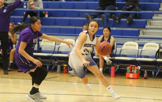 Bloomfield's Madison Bedonie drives toward the basket against Miyamura's Tatum Bennett during Saturday's District 1-4A girls basketball game at Bobcat Gym in Bloomfield.