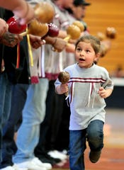 Dominic Duro Jr., 3, of the Torres Martinez tribe participates in Agua Caliente's annual Singing of the Birds event held at Palm Springs High School in Palm Springs, Calif., on Saturday, February 1, 2020.