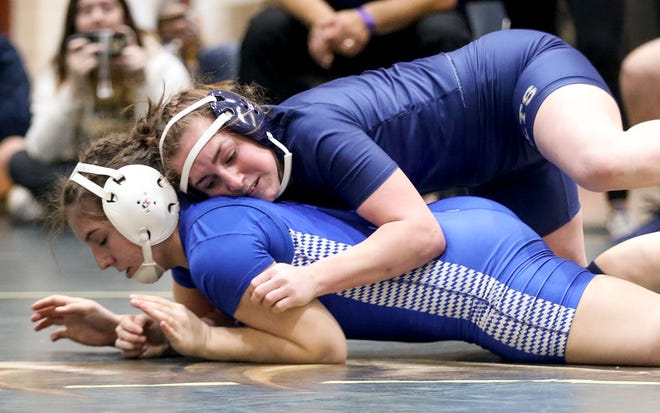 Casteel's Camry Carter rides Chandler's Ryleigh Dye during their 135 pound match in the Girls Div I Sec 5 meet at Basha High School in Chandler Feb 1, 2020.