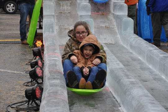 Aden Hollenshead of St. Thomas and his sister Addyson rode the 40-foot ice slide over and over at IceFest on Saturday, Feb. 1, 2020, in downtown Chambersburg.