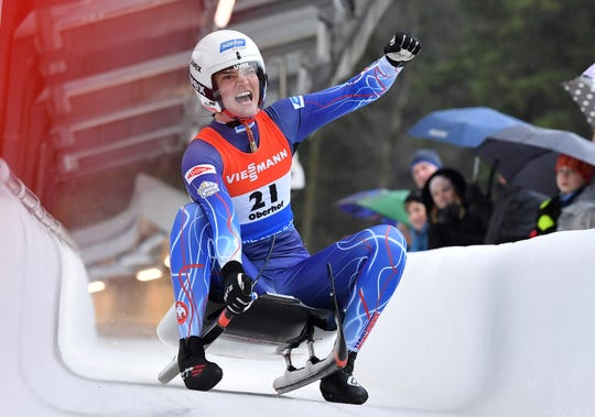 Summer Britcher from the USA cheers at the finish line after finishing third at the luge world cup in Oberhof, Germany, Sunday, Feb.2, 2020. (Martin Schutt/dpa via AP)