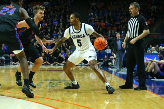 Nevada guard Nisre Zouzoua looks to get past the Boise State defense during Saturday's game.