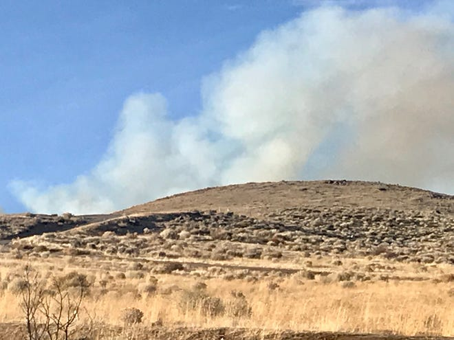 Smoke is seen billowing from a hillside near Peavine Mountain on Saturday, Feb. 1, 2020. The fire was estimated at 15 acres.