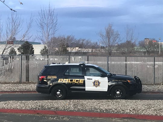 A Reno police patrol vehicle is seen at the scene where a body was discovered in the Truckee River just south of Glendale Avenue on Saturday, Feb. 2, 2020.