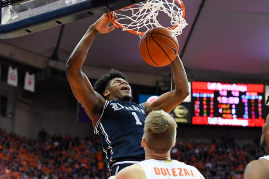 Feb 1, 2020; Syracuse, New York, USA; Duke Blue Devils center Vernon Carey Jr. (1) dunks the ball over Syracuse Orange forward Quincy Guerrier (1) during the first half at the Carrier Dome. Mandatory Credit: Rich Barnes-USA TODAY Sports
