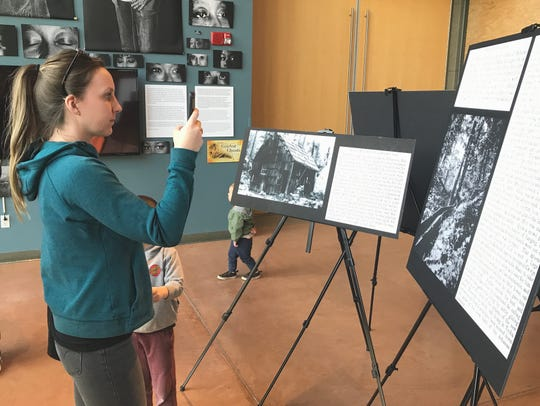 "Nicole Regalado of Lakehead photographs displays at the ""Voices of the Golden Ghosts"" museum exhibit at Turtle Bay Exploration Park on Saturday, Feb. 1, 2020. Regalado took the pictures so she could have more time to read the text at home."