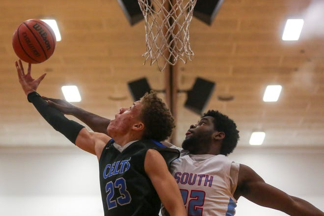 McNary's Nate Meithof, 23, attempts to score while South's Emorej Lynk, 22, defends during their boys basketball game on Feb. 1, 2020 at South Salem High School.