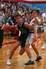 McNary's Nate Meithof, 23, drives the ball toward the basket during their boys basketball game against South Salem on Feb. 1, 2020 at South Salem High School.