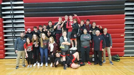 The Brandon Valley wrestling team celebrates after winning the Brookings Invitational on Feb. 1.