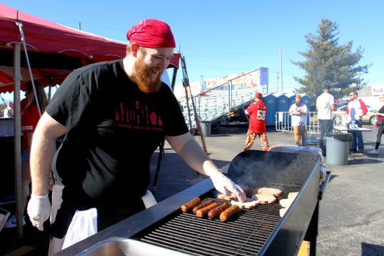 Coyote's Adobe Cafe cook Bob Oglesby grills burgers and brats before the Super Bowl Sunday, Feb. 2, 2020.