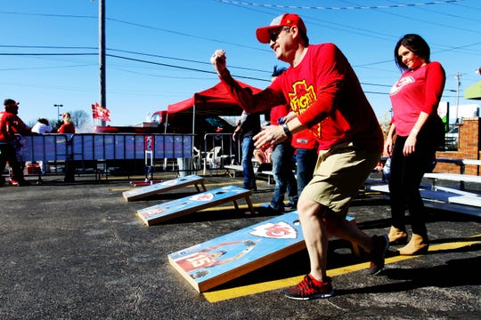 Rob Harris, of Springfield, plays cornhole before the Super Bowl game at Coyote's Adobe Cafe Sunday, Feb. 2, 2020.
