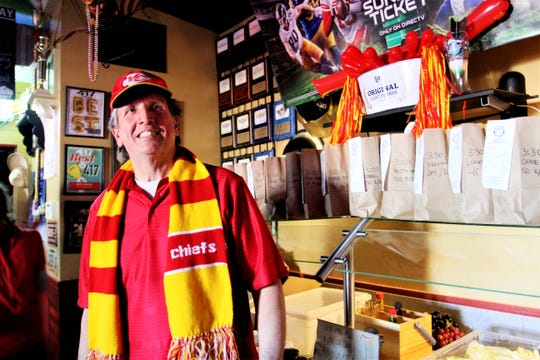 Owner David Bauer stands in front of numerous orders of chicken wings at Coyote's Adobe Cafe ahead of the Super Bowl game between the Chiefs and 49ers Sunday, Feb. 2, 2020.