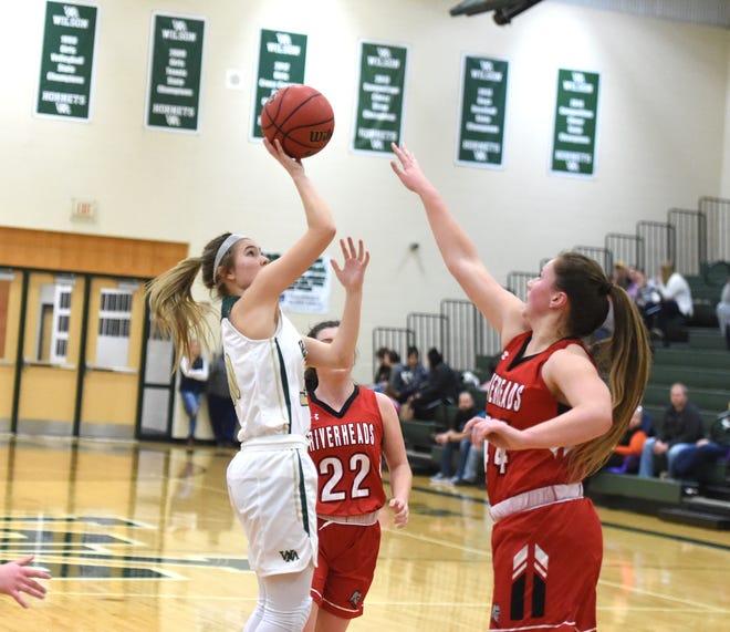 Wilson Memorial's Korinne Baska shoots over Riverheads' Berkeley Tyree in a Shenandoah District girls basketball game in Fishersville Saturday, Feb. 1