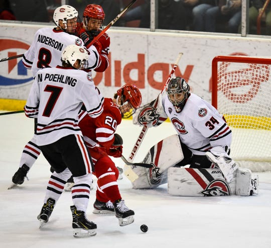 St. Cloud State goaltender David Hrenak concentrates on the puck during the first period of the Saturday, Feb. 1, 2020, game at the Herb Brooks National Hockey Center in St. Cloud.
