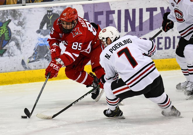 Miami's Karch Bachman tries to get past Nick Poehling of St. Cloud State during the first period of the Saturday, Feb. 1, 2020, game at the Herb Brooks National Hockey Center in St. Cloud.