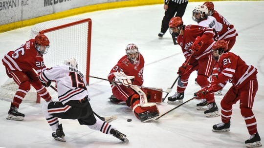 St. Cloud State's Sam Hentges takes a shot on Miami goaltender Ben Kraws during the first period of the Saturday, Feb. 1, 2020, game at the Herb Brooks National Hockey Center in St. Cloud.
