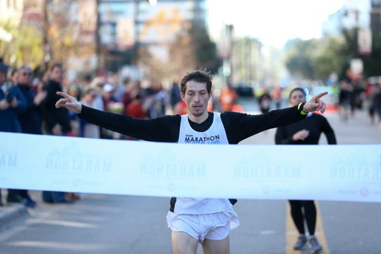 Bryan Morseman from Bath, New York finishes first for men in the full Tallahassee Marathon Sunday, Feb. 2, 2020.