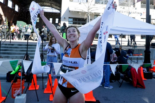 Debbie Greig of Aberdeen, Scotland celebrates after finishing first for women in the full Tallahassee Marathon Sunday, Feb. 2, 2020.