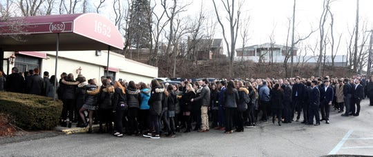 Mourners line up outside the Weinstein Memorial Chapel in Yonkers before the funeral of Eric Goldberg Feb. 2, 2020. Goldberg was the 17-year old Ardsley High School student who died in Thursday night's wrong-way crash on Interstate 287.