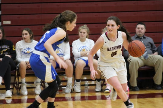 Harrison's Ashley Stagg attempts to drive past Mahopac's Melanie DeMeo, during the Huskies' 57-46 victory on Saturday, Feb. 1, 2020.