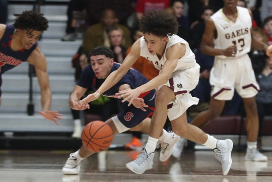 Stepinac's Justin Morety (0) and Iona's Isaac Gonzalez (10) battle for a loose ball during basketball action the Hynes Center at Iona College in New Rochelle Feb. 1, 2020. Iona won the game 66-61.