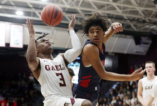 From left, Iona's Marquis Dukes (3) and Stepinac's R.J. Davis (1) battle for a rebound  during basketball action the Hynes Center at Iona College in New Rochelle Feb. 1, 2020.