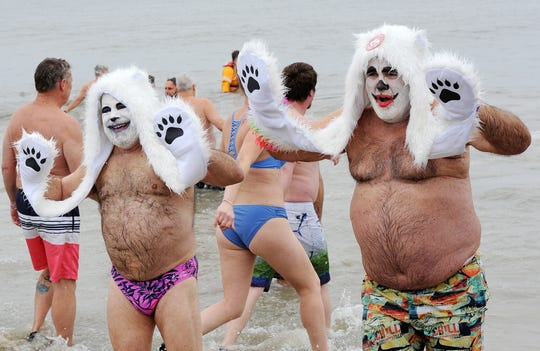 As part of the 29th annual Letheys Polar Bear Plunge, several thousand people ran into the chilly Atlantic Ocean on Feb. 2 at Rehoboth Beach to raise money for Special Olympics Delaware.