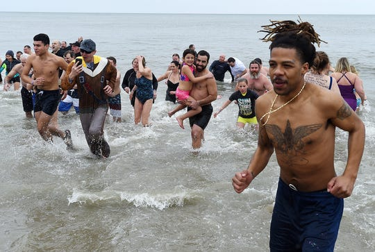 As part of the 29th annual Lewes Polar Bear Plunge, several thousand people ran into the chilly Atlantic Ocean on Feb. 2 at Rehoboth Beach to raise money for Special Olympics Delaware.