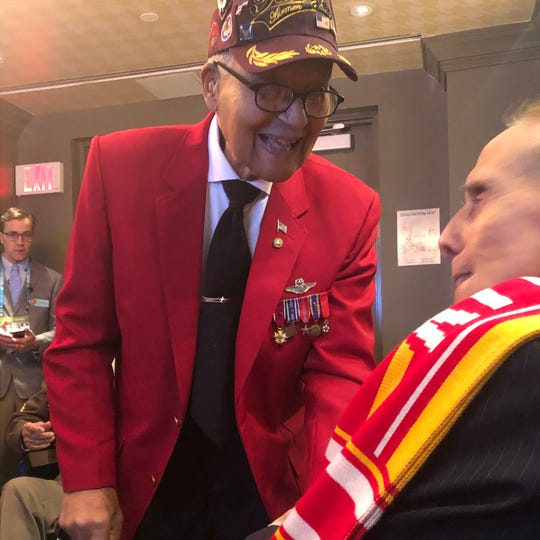 Retired Colonel Charles McGee, left, talks with former Senator Bob Dole before participating in the coin toss for Super Bowl LIV.