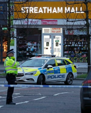 Police secure an area in the Streatham neighborhood of London on Feb. 2, 2020, after a stabbing incident.