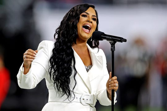 Recording artist Demi Lovato performs the national anthem before Super Bowl LIV.