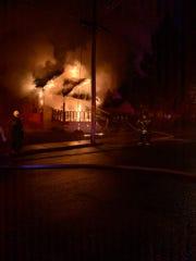 A fire in Neptune burns a McBride Avenue home.