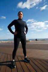 Runner Kelly Herron strikes a pose on the Belmar Boardwalk