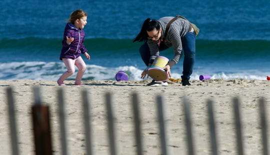 Laura Webster, Howell, and her daughter Cayleen, 4, enjoy the sunshine and play in the sand on the Belmar shoreline Monday, February 3, 2020.