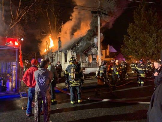 A fire in Neptune burns a McBride Avenue home on Sunday evening.