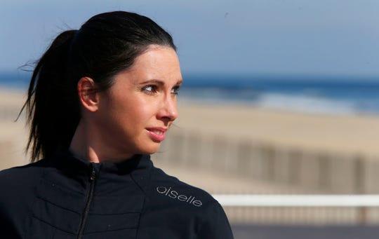 Kelly Herron looks towards the ocean from the Belmar Boardwalk