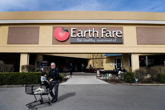 People shop at Earth Fare at Westgate Shopping Center February 3, 2020, the day the establishment announced it would be closing.