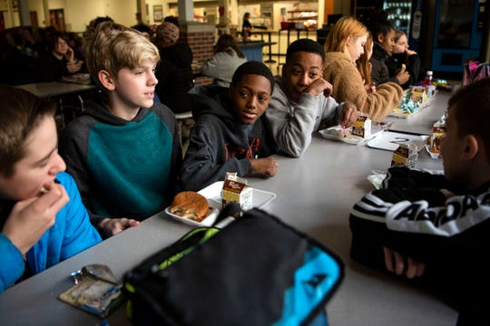 Sixth graders Sam Alexandrian, Tayden Neeley, Carmello Hall and Javion Hancock eat lunch together at Marshall Middle School on Monday, Feb. 3, 2020 in Marshall, Mich. Overwhelmed with debt, Albion schools closed and merged with Marshall in 2016; as districts around the state face the same crises as Albion, schools are looking to the Marshall merge for guidance.