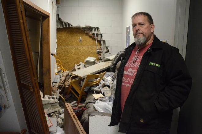 Victor Wright inside his damaged building.