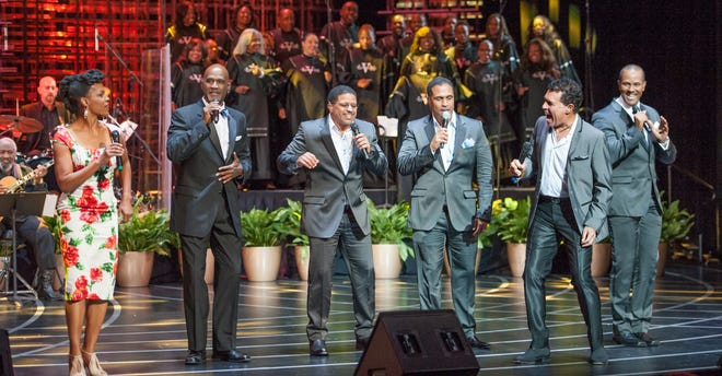 "Nnenna Freelon (left), Clint Holmes (second from right) and members of Take 6 on stage during a performance of ""Georgia on My Mind: Celebrating the Music of Ray Charles."""