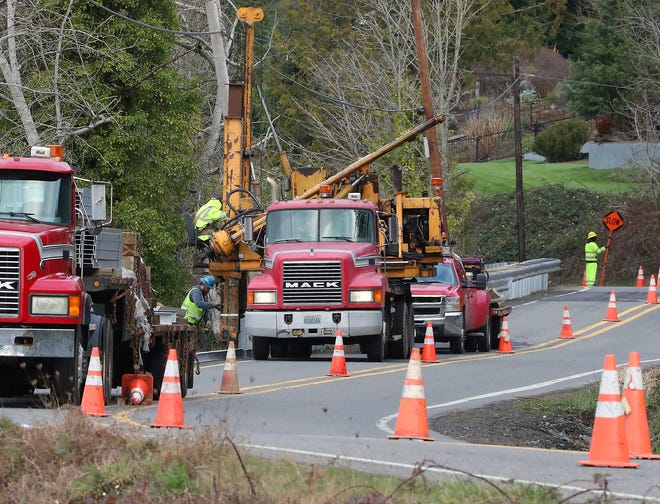 FILE — Crews install guard rails along Tracyton Beach Road just north of Pat Carey Vista in Bremerton in February 2020.
