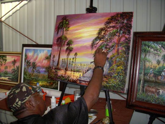 Highwaymen artist R.L. Lewis painting at the Tallahassee Museum of History and Natural Science's annual Market Days fund raiser at the Leon County Fairgrounds in 2007.